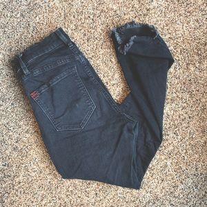 Faded black skinny jeans.